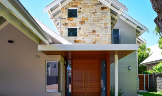 external shot of a residential build in dunsborough highlighting the stone feature wall and timber roof cladding
